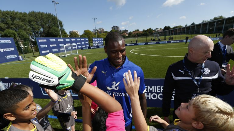 Wes Morgan of Leicester City participates in a training session with young people during the Official Premier League Season Launch