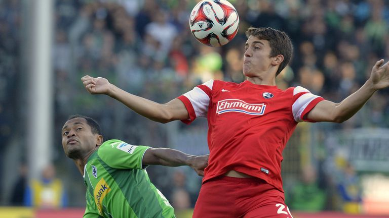 Freiburg's Marc-Oliver Kempf (right) in action on Sunday
