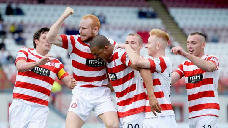 Hamilton's Mickael Antoine Curier celebrates with team-mates after giving his side the 2-0 lead over Ross County