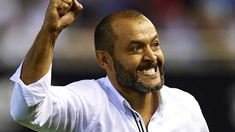 Valencia manager Nuno Espirito Santo celebrates the second goal against Malaga