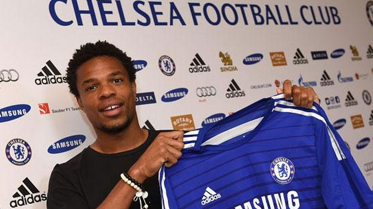 Loic Remy: Poses with his Chelsea shirt after signing from QPR