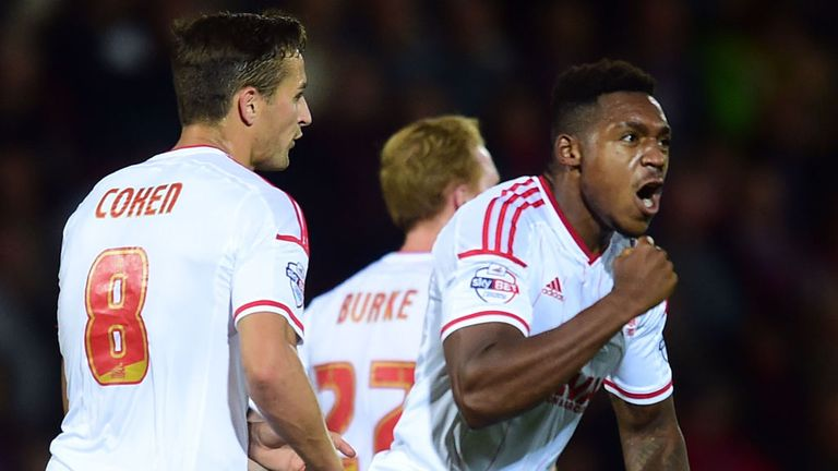 Assombalonga: Celebrates goal at Dean Court