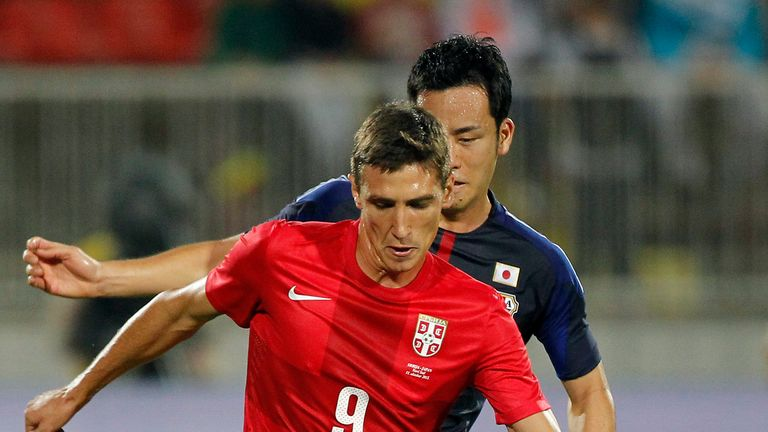 Stefan Scepovic (f) of Serbia in action against Japan