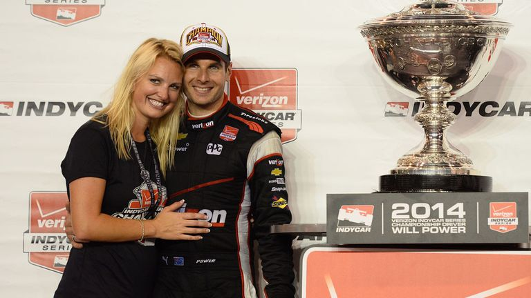 Wil Power with wife Elizabeth after clinching the IndyCar title on Saturday