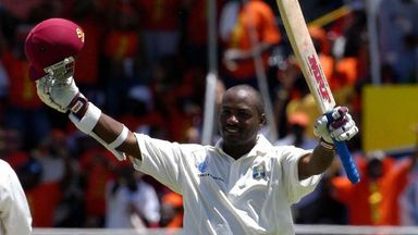 Brian Lara acknowledges the applause as he compiles a world record 400no against England
