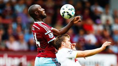 Carlton Cole: West Ham striker (l) in action against Tottenham