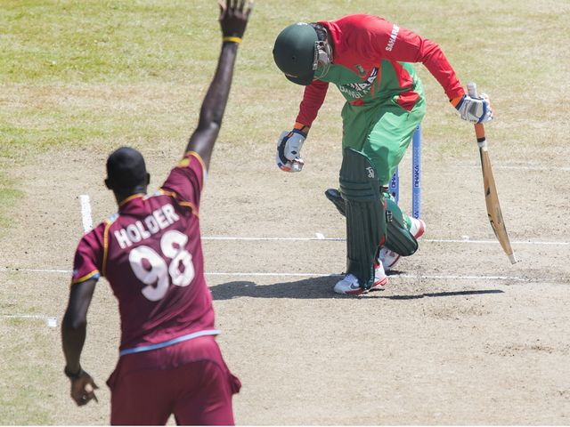 Jason Holder takes the wicket of Anamul Hoque Bijoy