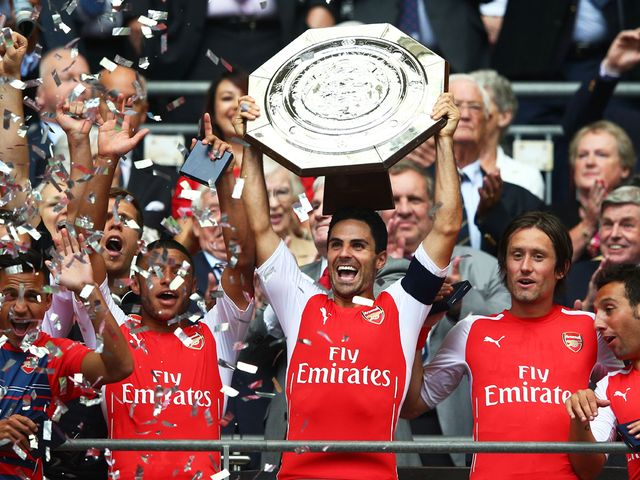 Arsenal skipper Mikel Arteta holds the Community Shield aloft