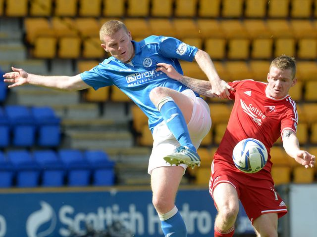 Brian Easton goes up against Jonny Hayes