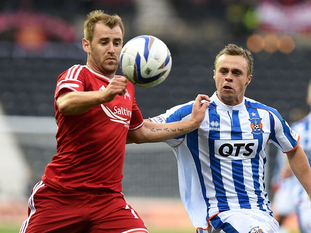 Aberdeen's Niall McGinn goes up against Chris Chantler