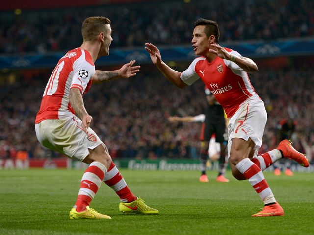 Arsenal's Alexis Sanchez celebrates scoring with Jack Wilshere