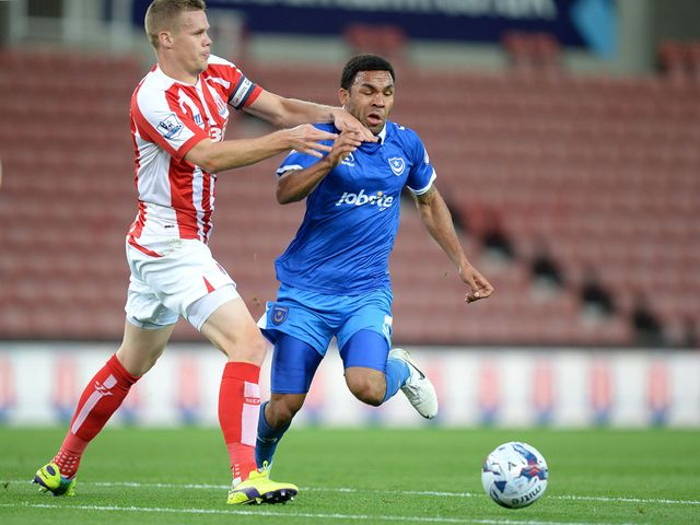 Portsmouth's Andy Barcham battles for the ball with Stoke City's Ryan Shawcross