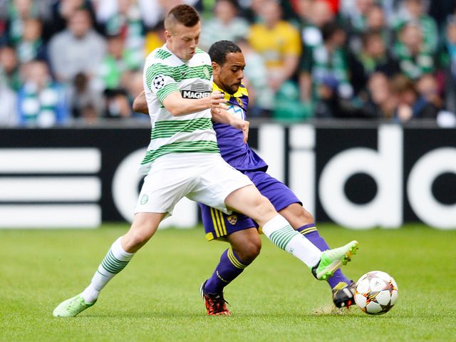 Celtic's Callum McGregor (left) battles for the ball