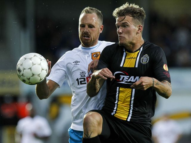 Hull's David Meyler (l) battles for possession