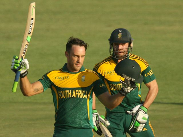 Faf du Plessis (l) celebrates his century with captain AB de Villiers