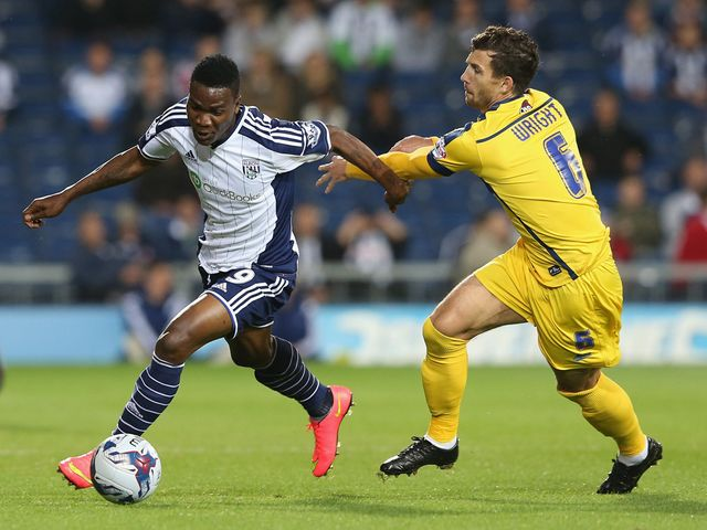Brown Ideye of West Brom moves away from Jake Wright
