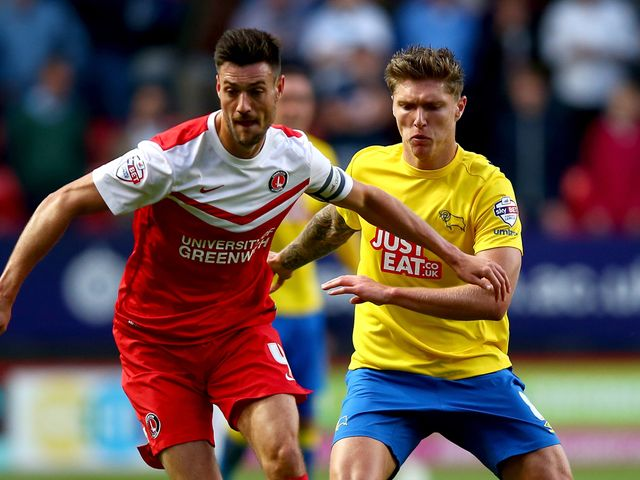 Johnnie Jackson of Charlton controls the ball from Jeff Hendrik