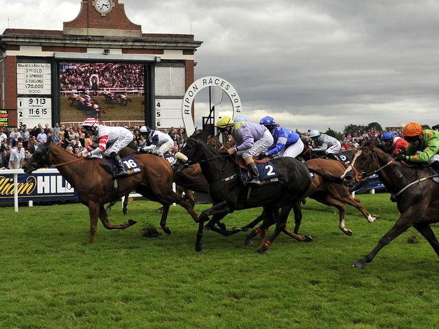Out Do and Daniel Tudhope (no 16) win the William Hill Great St Wilfrid Stakes