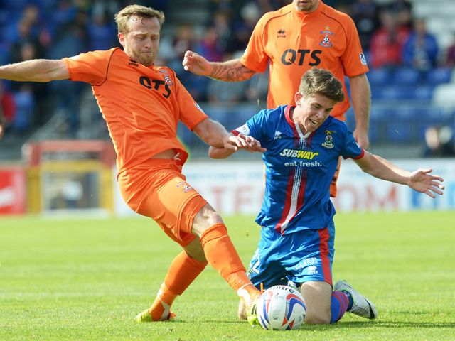 Kilmarnock's Sammy Clingan (left) battles with Ryan Christie