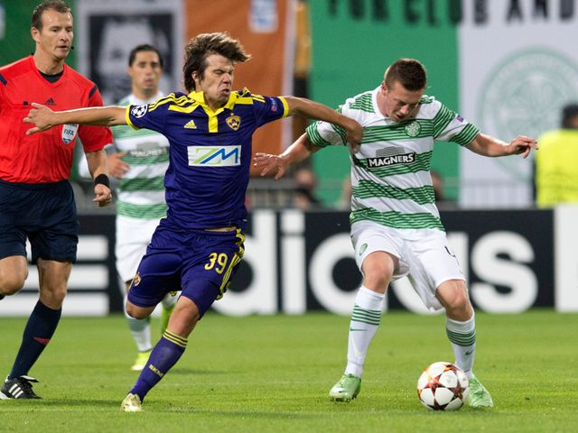 Damjan Bohan and Callum McGregor battle for the ball