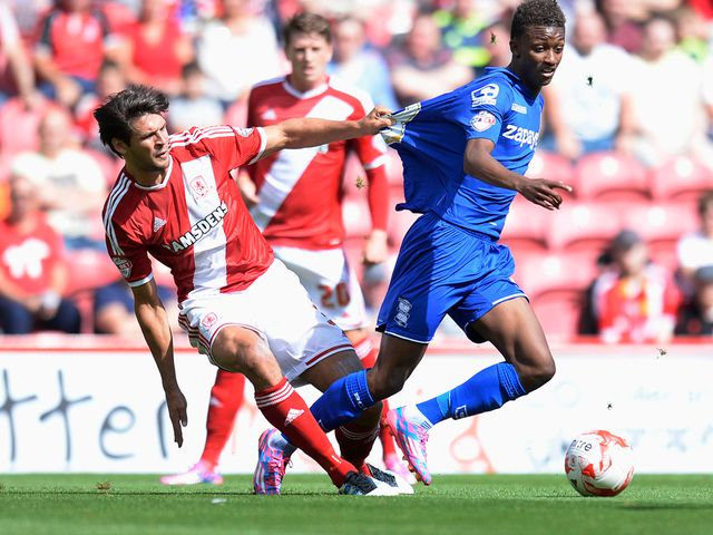 Middlesbrough's George Friend and Birmingham's Demarai Gray in action
