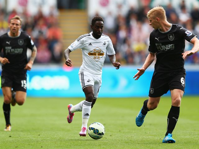 Nathan Dyer runs at Ben Mee