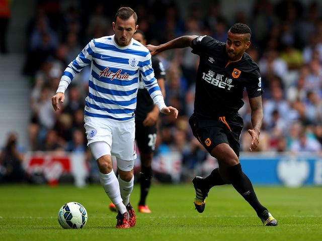 Tom Huddlestone of Hull City marshalls Jordan Mutch of QPR