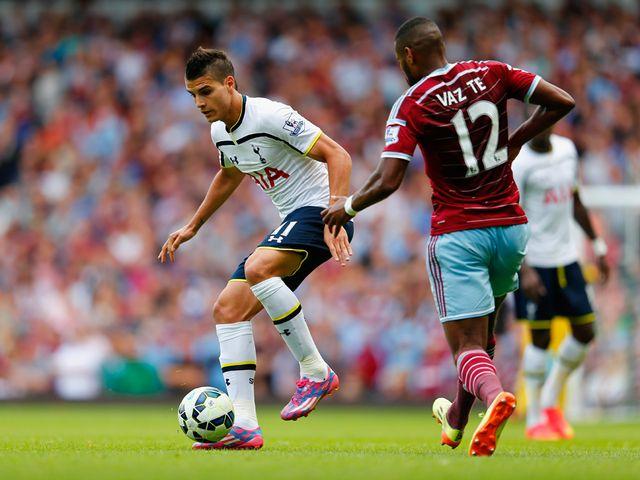 Erik Lamela of Tottenham holds off Ricardo Vaz Te