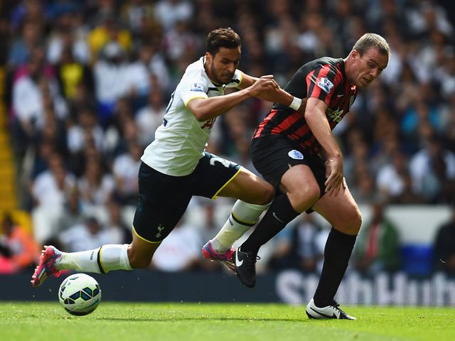 Richard Dunne and Nacer Chadli tangle