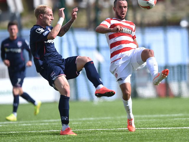 Ross County's Uros Celcer (left) challenges Dougie Imrie