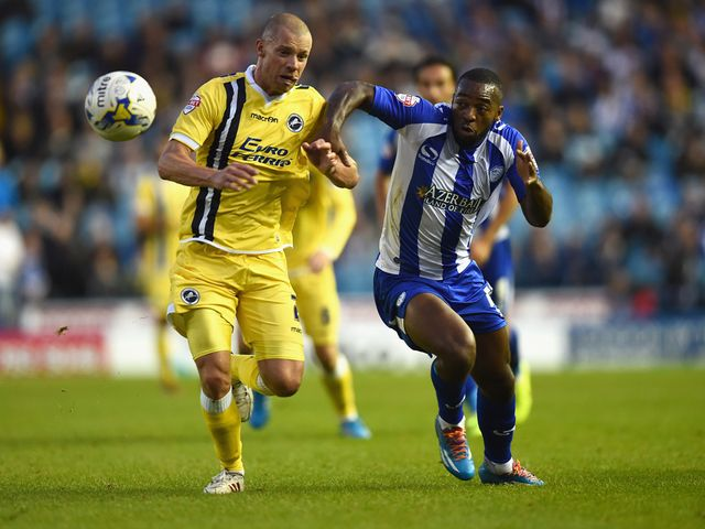 Jaques Maghoma battles with Alan Dunne of Millwall