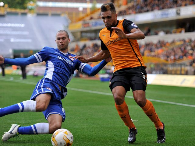 Scott Golbourne is tackled by Matthew Connolly