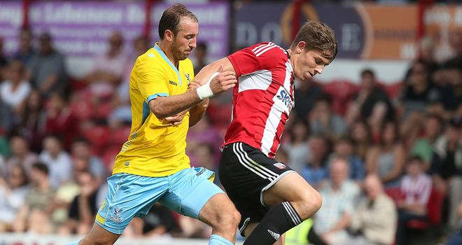 James Tarkowski: Holds off Palace goalscorer Glenn Murray