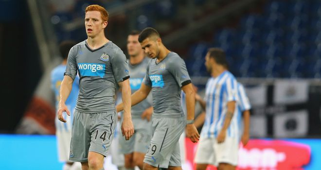 Jack Colback and Medhi Abeid: Look on as Malaga celebrate third goal