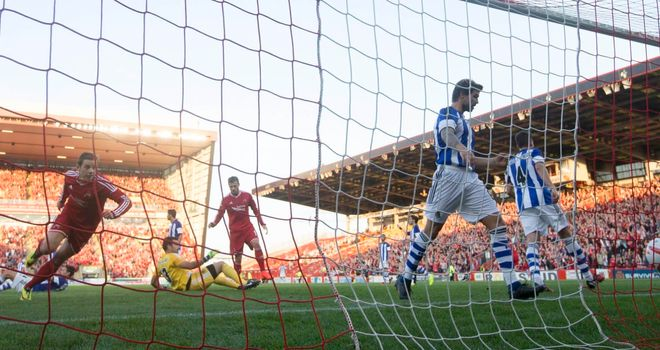 Peter Pawlett scores for Aberdeen, but Real Sociedad triumphed 3-2 on the night