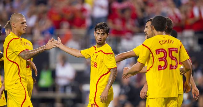 Suso is congratulated by teammates after scoring late on in the 2-0 win over AC Milan