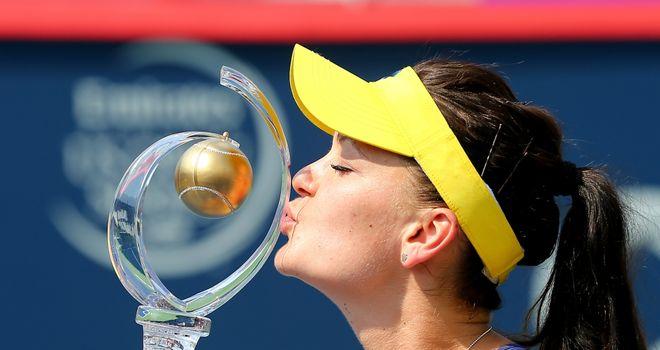 Agnieszka Radwanska: Kisses the trophy after defeating Venus Williams