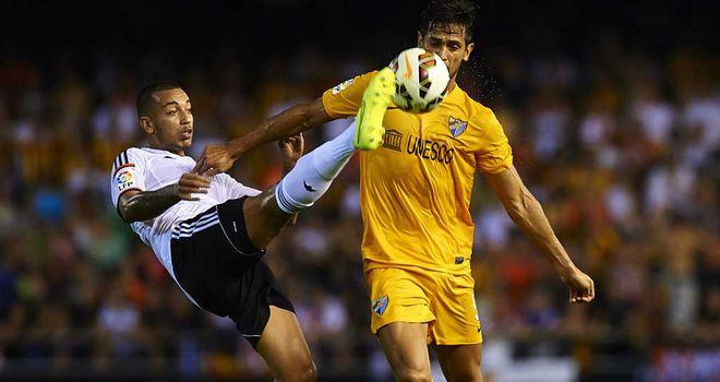 Ruben Vezo of Valencia competes for the ball with Roque Santa Cruz