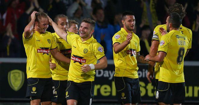 Burton Albion' s Adam McGurk (left) celebrates scoring the winner