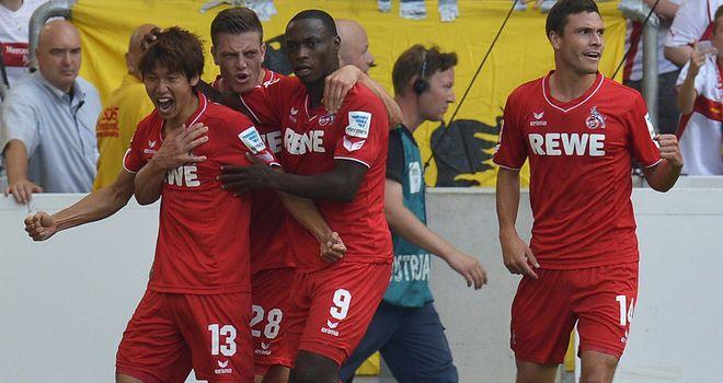 Cologne's Japanese forward Yuya Osako (l) celebrates his goal