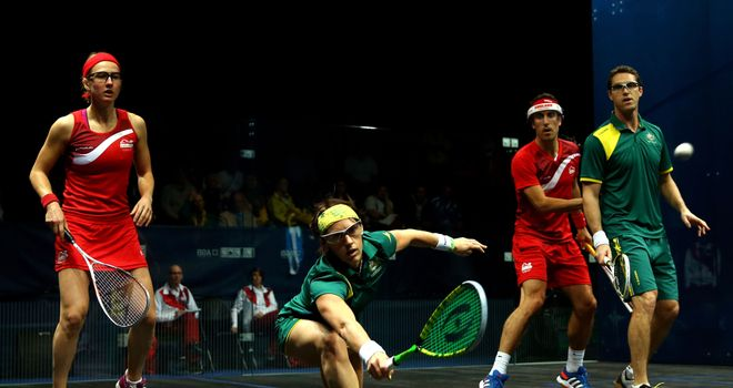 Rachael Grinham of Australia plays a shot in the gold medal match against England's Alison Waters and Peter Barker
