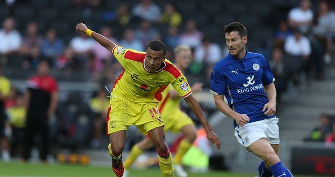 Dele Alli: Holds off goalscorer David Nugent in MK Dons' friendly defeat