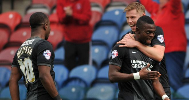 Igor Vetokele (right): Celebrates Charlton's late equaliser at Huddersfield