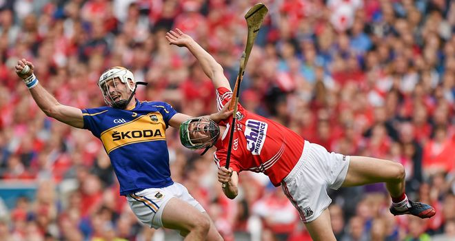 Tipperary defender Padraic Maher beats Seamus Harnedy to the ball
