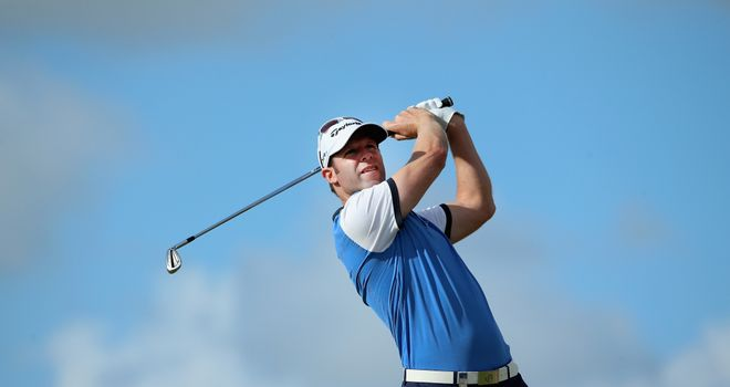 Bradley Dredge of Wales hits his tee-shot on the tenth hole during the second round
