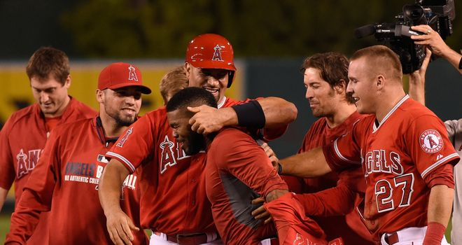 Howie Kendrick is congratulated by Los Angeles Angels team-mate Albert Pujols