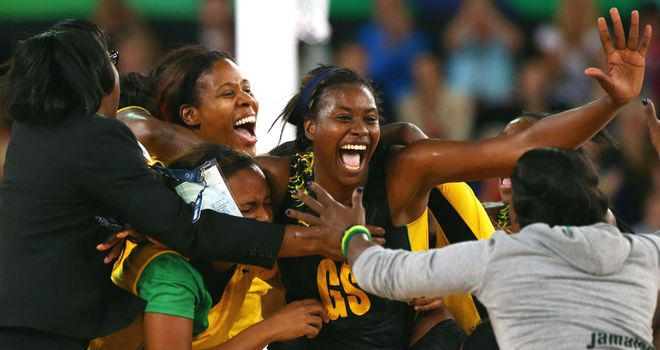 Romelda Aiken and her Jamaican team-mates celebrate victory against England in the bronze medal match