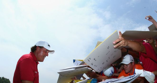 Phil Mickelson signs autographs for his fans at Valhalla during Tuesday's practice