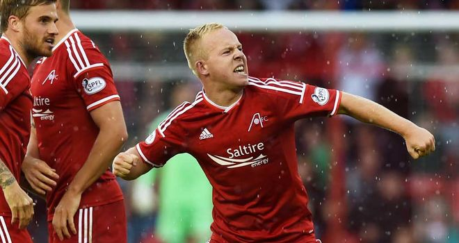 Nicky Low celebrates his goal for Aberdeen against Partick Thistle