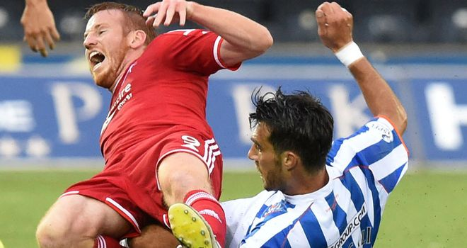 Manuel Pascali (r): Slides in on Adam Rooney at Rugby Park